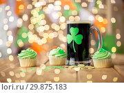 Купить «shamrock on glass of beer, green cupcake and coins», фото № 29875183, снято 31 января 2018 г. (c) Syda Productions / Фотобанк Лори