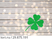 Купить «green paper four-leaf clover on wooden background», фото № 29875191, снято 31 января 2018 г. (c) Syda Productions / Фотобанк Лори