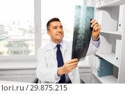 Купить «doctor with x-ray scan at hospital», фото № 29875215, снято 3 февраля 2015 г. (c) Syda Productions / Фотобанк Лори