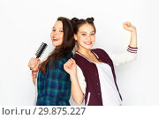 Купить «teenage girls singing to hairbrush and having fun», фото № 29875227, снято 19 декабря 2015 г. (c) Syda Productions / Фотобанк Лори