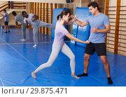 Купить «People practicing self defense techniques», фото № 29875471, снято 31 октября 2018 г. (c) Яков Филимонов / Фотобанк Лори