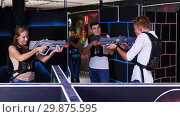 Купить «guys and girls playing laser tag game», фото № 29875595, снято 27 августа 2018 г. (c) Яков Филимонов / Фотобанк Лори