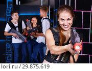 Купить «Portrait of exciting girl with laser pistol playing laser tag in dark room», фото № 29875619, снято 27 августа 2018 г. (c) Яков Филимонов / Фотобанк Лори