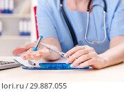 Female doctor neurologist working in the clinic. Стоковое фото, фотограф Elnur / Фотобанк Лори