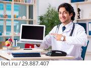 Купить «Young handsome doctor in telemedicine concept», фото № 29887407, снято 12 ноября 2018 г. (c) Elnur / Фотобанк Лори