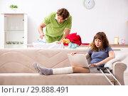 Купить «Husband helping leg injured wife in housework», фото № 29888491, снято 4 октября 2018 г. (c) Elnur / Фотобанк Лори