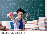 Young male student studying math at school. Стоковое фото, фотограф Elnur / Фотобанк Лори