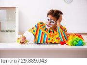Купить «Male clown preparing for perfomance at home», фото № 29889043, снято 28 сентября 2018 г. (c) Elnur / Фотобанк Лори
