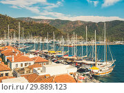 Beautiful Panoramic Aerial view at of boats, yacht, sailboat and bay in Marmaris, Turkey. Colorful landscape with boats in marina bay, sea, city, mountains. Стоковое фото, фотограф Сергей Тимофеев / Фотобанк Лори