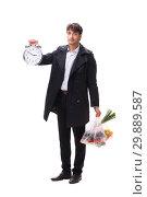 Купить «Young handsome man with vegatables in shopping concept», фото № 29889587, снято 3 августа 2018 г. (c) Elnur / Фотобанк Лори