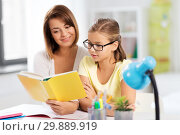 Купить «mother and daughter doing homework together», фото № 29889919, снято 7 октября 2018 г. (c) Syda Productions / Фотобанк Лори