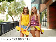 Купить «teenage girls with short skateboards in city», фото № 29890015, снято 19 июля 2018 г. (c) Syda Productions / Фотобанк Лори