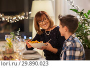 grandmother and grandson having dinner at home. Стоковое фото, фотограф Syda Productions / Фотобанк Лори