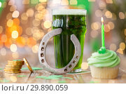 Купить «glass of beer, cupcake, horseshoe and gold coins», фото № 29890059, снято 31 января 2018 г. (c) Syda Productions / Фотобанк Лори