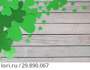 Купить «green paper shamrocks on wooden background», фото № 29890067, снято 31 января 2018 г. (c) Syda Productions / Фотобанк Лори
