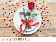 Купить «close up of red rose flower on set of dishes», фото № 29890135, снято 9 февраля 2018 г. (c) Syda Productions / Фотобанк Лори