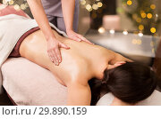 woman lying and having back massage at spa parlor. Стоковое фото, фотограф Syda Productions / Фотобанк Лори