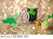 Купить «glass of beer, horseshoe, green cupcake and coins», фото № 29890167, снято 31 января 2018 г. (c) Syda Productions / Фотобанк Лори