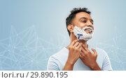 Купить «indian man shaving beard with razor blade», фото № 29890195, снято 27 октября 2018 г. (c) Syda Productions / Фотобанк Лори