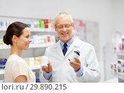 Купить «apothecary and woman with drug at pharmacy», фото № 29890215, снято 27 июня 2015 г. (c) Syda Productions / Фотобанк Лори