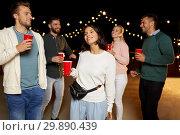 Купить «friends with drinks dancing at rooftop party», фото № 29890439, снято 2 сентября 2018 г. (c) Syda Productions / Фотобанк Лори