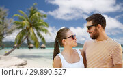 Купить «happy couple in sunglasses outdoors in summer», фото № 29890527, снято 15 июля 2018 г. (c) Syda Productions / Фотобанк Лори