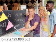 Купить «happy customers or friends at food truck», фото № 29890563, снято 1 августа 2017 г. (c) Syda Productions / Фотобанк Лори