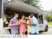 Купить «happy friends with drinks eating at food truck», фото № 29890575, снято 1 августа 2017 г. (c) Syda Productions / Фотобанк Лори
