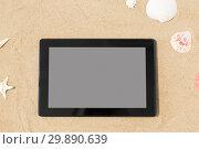 Купить «tablet computer and seashells on beach sand», фото № 29890639, снято 27 июня 2018 г. (c) Syda Productions / Фотобанк Лори