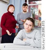 Купить «Upset woman during quarrel with family», фото № 29890815, снято 27 ноября 2017 г. (c) Яков Филимонов / Фотобанк Лори