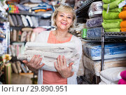 Купить «customer female choosing cotton tablecloths in the textile store», фото № 29890951, снято 29 ноября 2017 г. (c) Яков Филимонов / Фотобанк Лори