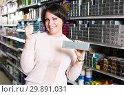 Купить «Female choosing hair dye», фото № 29891031, снято 22 мая 2019 г. (c) Яков Филимонов / Фотобанк Лори