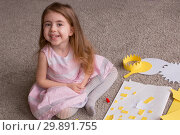 Happy cute little girl playing with craft and materials for needlework. Handmade. space for text. Стоковое фото, фотограф Константин Сиятский / Фотобанк Лори