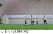Indoor football arena. Little kids playing football. Running on the field. Стоковое видео, видеограф Константин Шишкин / Фотобанк Лори