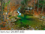Купить «Blue lake and mountain stream flowing in a canyon in the mountains in the autumn afternoon, beautiful view», фото № 29897643, снято 11 ноября 2017 г. (c) Константин Лабунский / Фотобанк Лори