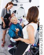Купить «Hairstylists and satisfied female customer after haircut», фото № 29898543, снято 26 июня 2018 г. (c) Яков Филимонов / Фотобанк Лори