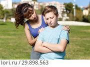 Купить «Mother berating son outdoors», фото № 29898563, снято 11 ноября 2018 г. (c) Яков Филимонов / Фотобанк Лори