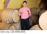Купить «Man posing in winery cellar», фото № 29898895, снято 21 сентября 2016 г. (c) Яков Филимонов / Фотобанк Лори