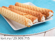 Купить «Gaufres de Montcuq, rolled wafers with cream filling», фото № 29909715, снято 14 января 2019 г. (c) Stockphoto / Фотобанк Лори