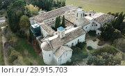 Купить «View from drone of ancient Romanesque monastery Sant Benet de Bagess, Catalonia, Spain», видеоролик № 29915703, снято 24 декабря 2018 г. (c) Яков Филимонов / Фотобанк Лори