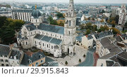 Купить «Aerial view of picturesque Chateauroux cityscape with Catholic Church of Our Lady, central France», видеоролик № 29915843, снято 26 октября 2018 г. (c) Яков Филимонов / Фотобанк Лори