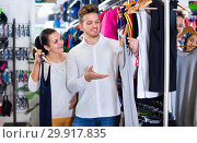 Купить «Couple choosing new sportswear in sports store», фото № 29917835, снято 22 ноября 2016 г. (c) Яков Филимонов / Фотобанк Лори