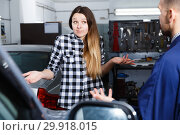 Young woman is disappointed of tire replacement of her car in spring. Стоковое фото, фотограф Яков Филимонов / Фотобанк Лори