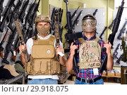 Купить «Male customers try on ammunition with weapon», фото № 29918075, снято 4 июля 2017 г. (c) Яков Филимонов / Фотобанк Лори