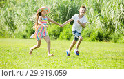 Купить «two happy children active playing and running outdoors», фото № 29919059, снято 22 февраля 2019 г. (c) Яков Филимонов / Фотобанк Лори