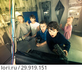 Купить «children play in the quest room of a inscrutable bunker», фото № 29919151, снято 21 октября 2017 г. (c) Яков Филимонов / Фотобанк Лори