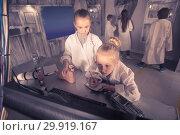 Купить «Children playing in bunker quest room», фото № 29919167, снято 21 октября 2017 г. (c) Яков Филимонов / Фотобанк Лори