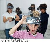 Купить «Enthusiastic children in virtual reality glasses in quest room», фото № 29919175, снято 21 октября 2017 г. (c) Яков Филимонов / Фотобанк Лори