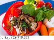 Купить «Peppers filled with porcini mushrooms, rice, tomatoes», фото № 29919335, снято 24 августа 2019 г. (c) Яков Филимонов / Фотобанк Лори