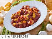 Купить «Fresh raw chicken hearts with vegetables», фото № 29919515, снято 17 сентября 2019 г. (c) Яков Филимонов / Фотобанк Лори
